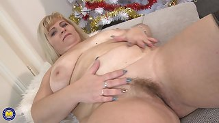 Chubby mature light-complexioned amateur BBW Stefana E. stuffs the brush pussy with toys