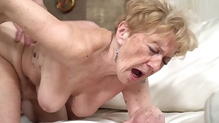 A nasty old granny is obtaining fucked adjacent to her pussy doggy style